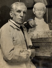 Thomas with bust of his young daughter