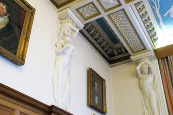 Some of the Caryatids supporting the Council Chamber Ceiling at UMIST - by Thomas Mewburn Crook